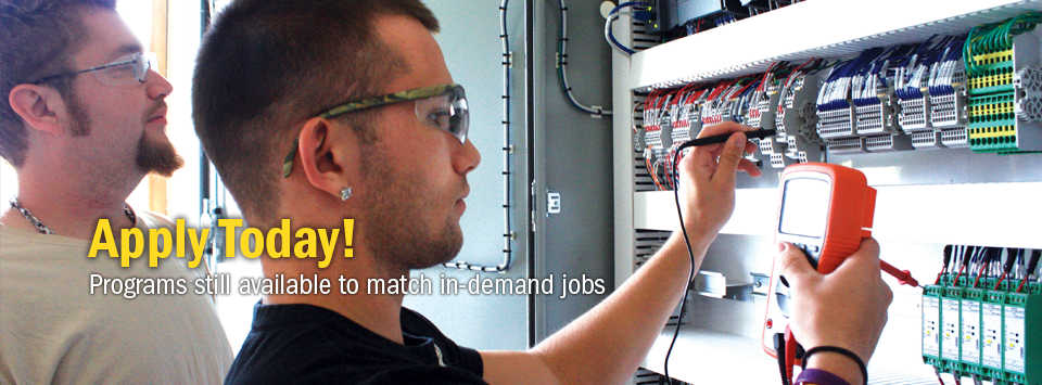 Apply Today! Programs still available to match in-demand jobs. Image of two students working on an electrical panel.