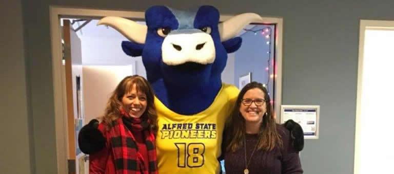 Elaine, Big Blue the ox mascot, and Maureen