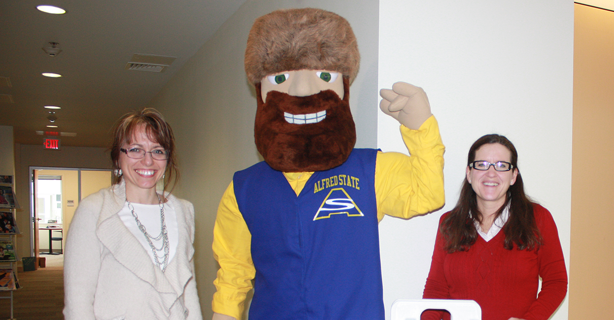 2 female Career Development staff with Orvis, the mascot