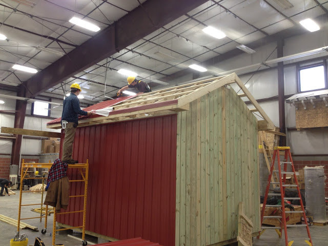 students building a shed in the lab