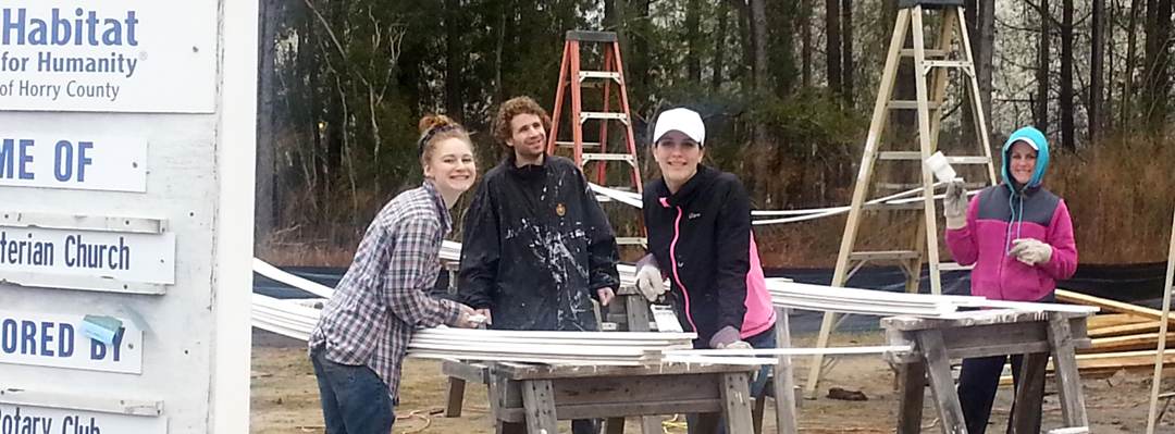 students painting on a project for Habitat for Humanity of Horry County