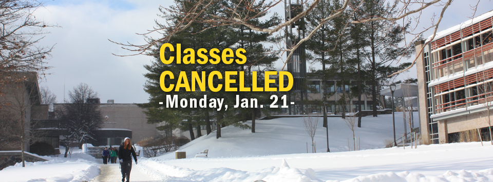 Classes Cancelled Monday Jan. 21. Image of snowy campus