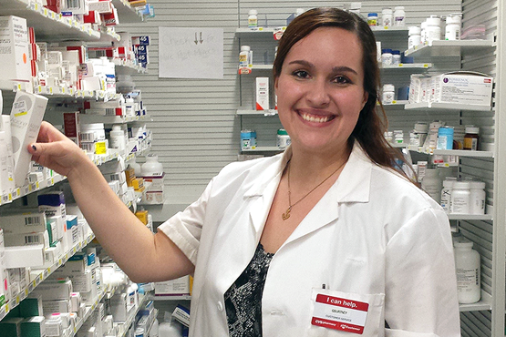 Courtney Cardinal in a pharmacy wearing a lab coat
