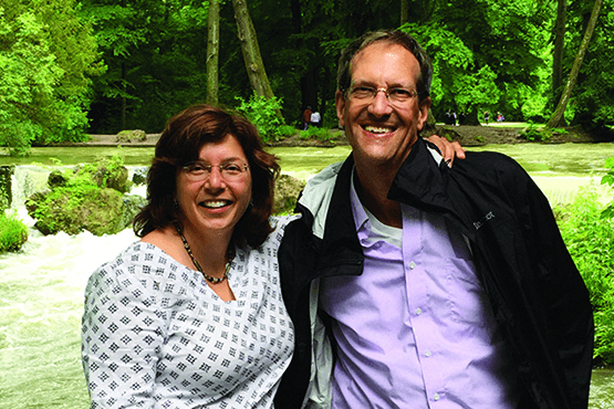 Tim and Deborah (Wallace) Moore in a wooded area