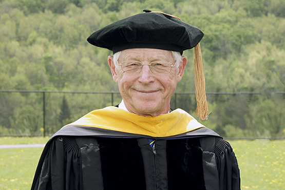 Dr. James Ferry with cap and gown on