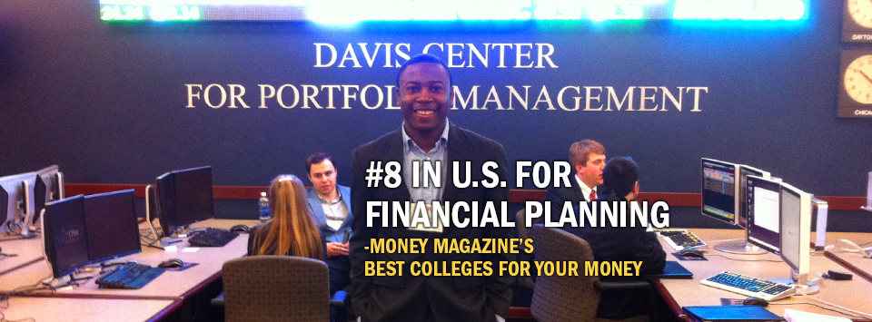 #8 in U.S. for Financial Planning - Money Magazine's Best Colleges for your Money. Image of male student at Davis Center for Portfolio Management during a class trip.