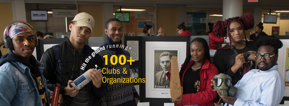 Hit the ground running®.... 100+ Clubs and Organizations. Image of students with items on display for black history month.