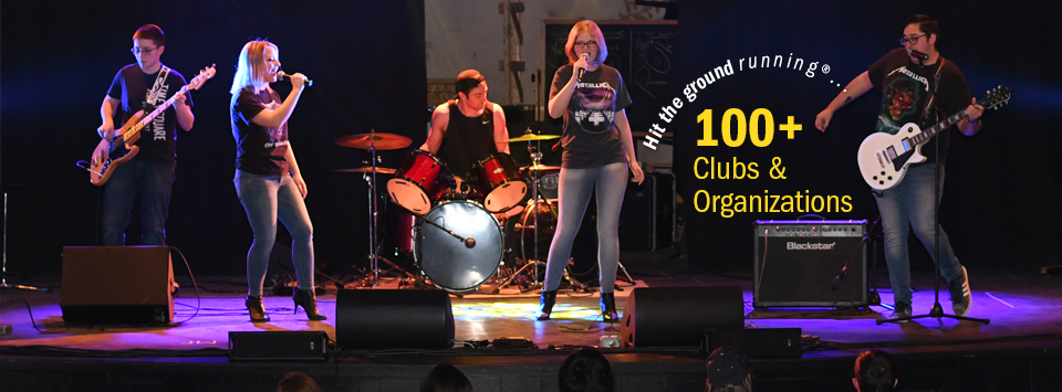 Hit the ground running®.... 100+ Clubs and Organizations. Image of students in the rock band club performing on stage.