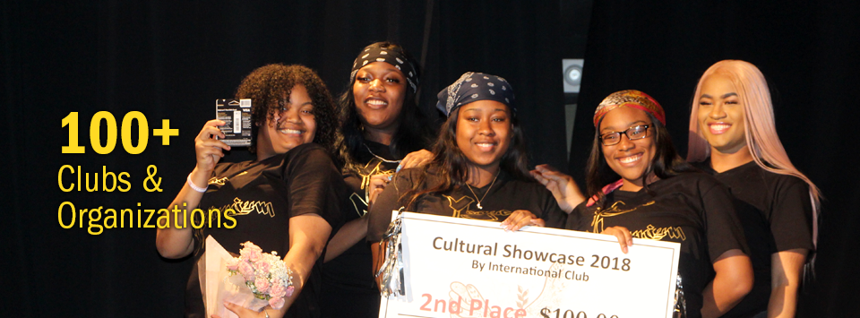 100+ Clubs and Organizations. Image of dance team posing with 2nd place award at cultural showcase
