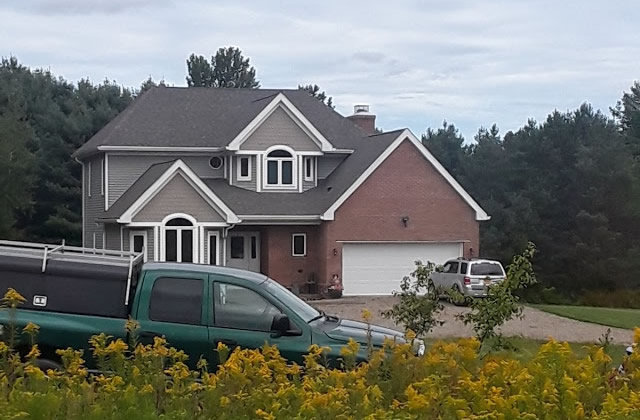 house with truck in front of it
