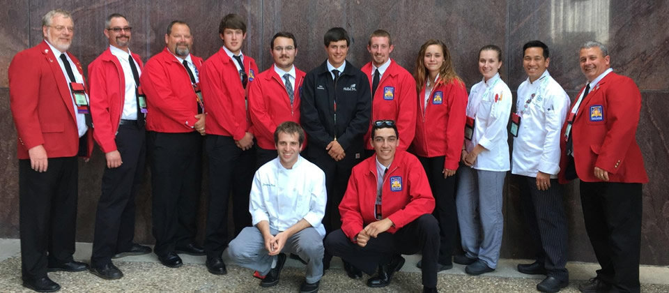 students wearing red suit coats at SkillsUSA competition