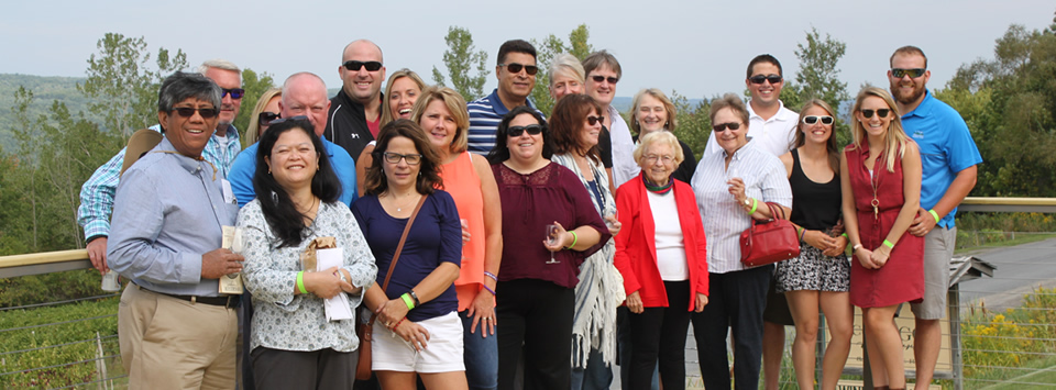 alumni on balcony of a winery