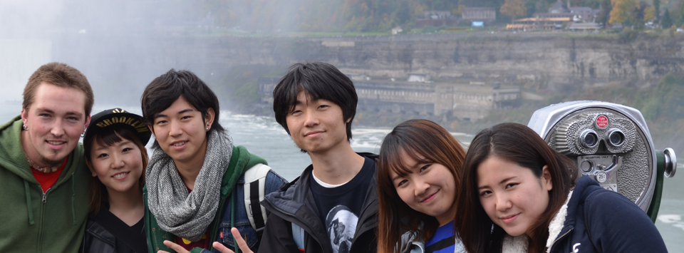 several students in front of Niagara Falls on a field trip