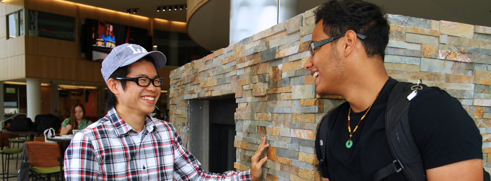 2 male students in front of fireplace at Student Leadership Center