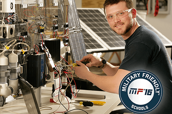 Jordon Williams at the solar lab, Military Friendly Schools 2016 logo in corner