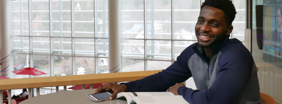Male international student studying in the Student Leadership Center