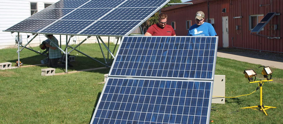 solar panels and two male students