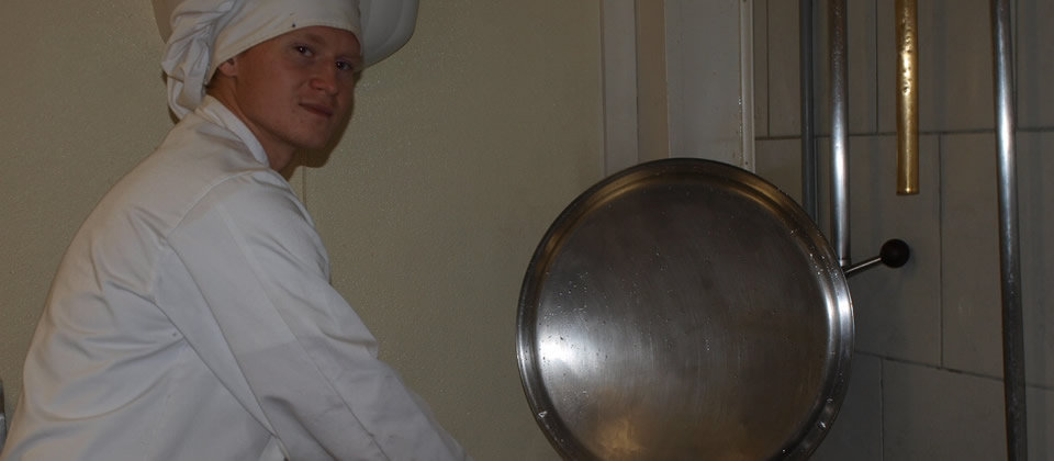 student next to a pot