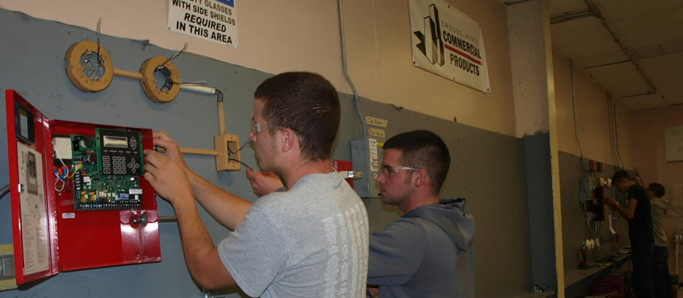 student working on electrical equipment