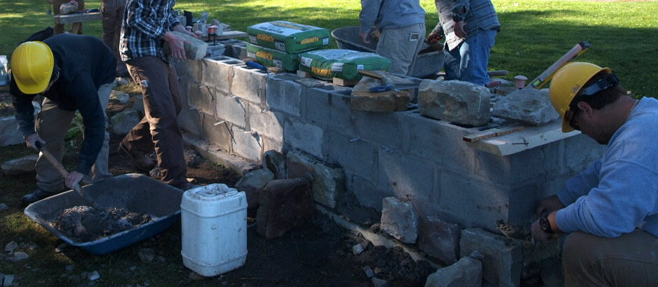 students working on masonry project