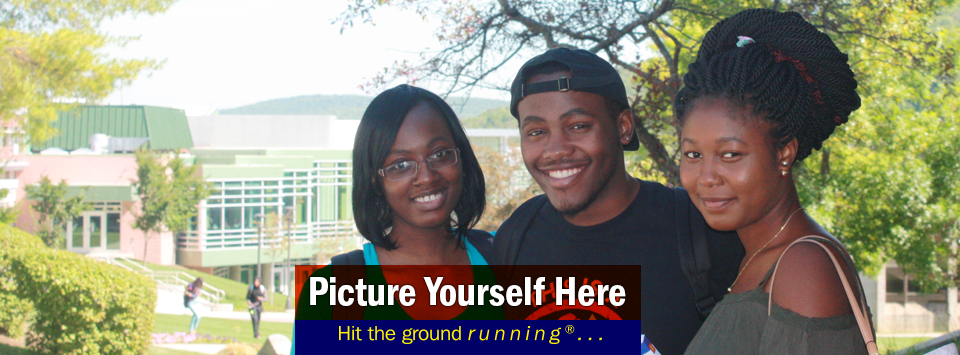 Three students smile for the camera, dining hall in the distance.  Picture Yourself Here, Hit the ground running®...