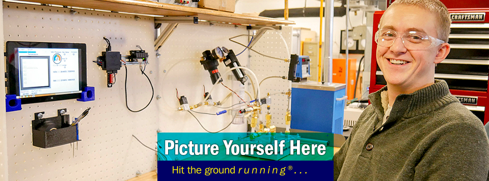 Mechanical Engineering Technology student at lab bench smiles at camera. Text reads: Picture Yourself Here, Hit the ground running®...