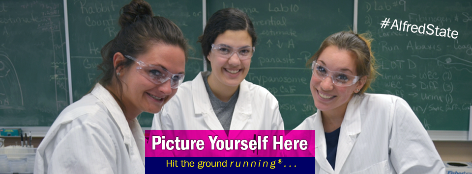 Group of students in white lab coats smile for the camera during lab. Picture Yourself Here, Hit the ground running