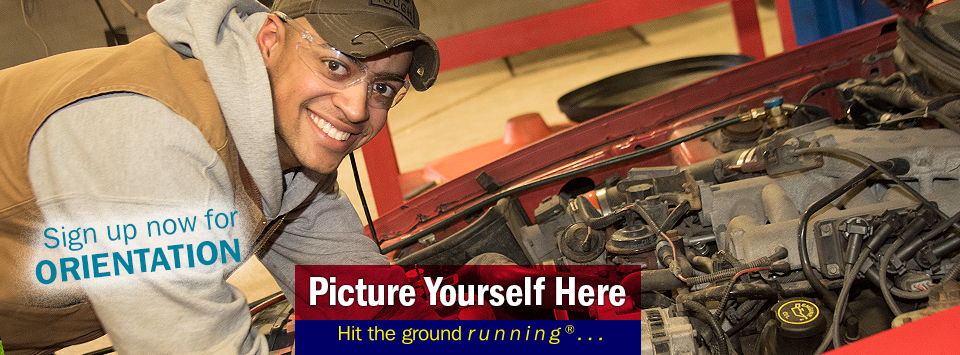 A male automotive service technician student poses for a photo under the hood of a car. Sign up for Orientation. Picture Yourself Here, Hit the ground running.