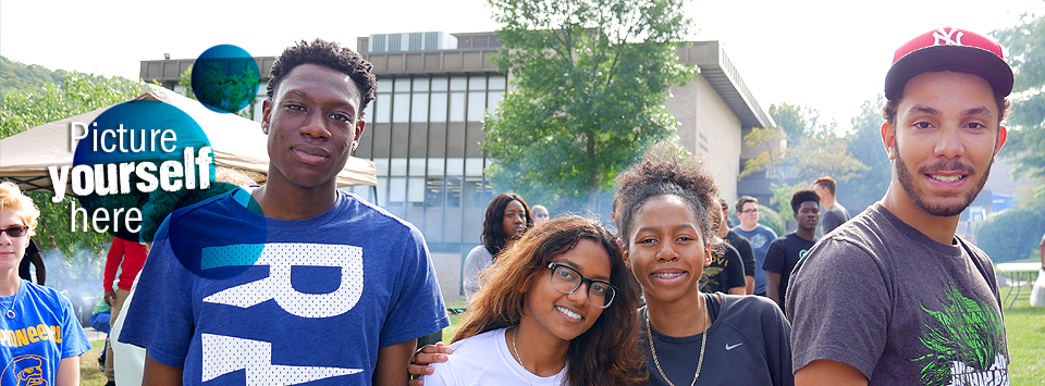 Picture yourself here. Image of students enjoying a block party on campus.