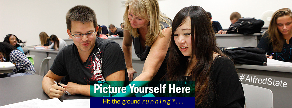 Students in lecture hall getting help from faculty. Picture Yourself Here, Hit the ground running.#AlfredState