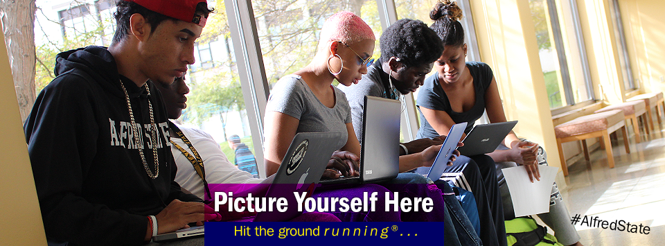 Group of students working on laptops in a sunny hallway. Picture Yourself Here, Hit the ground running®...