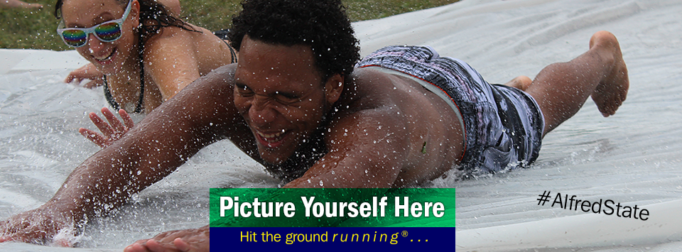 Students having fun in the sun on home made slip-n-slide. Picture Yourself Here, Hit the ground running.#AlfredState