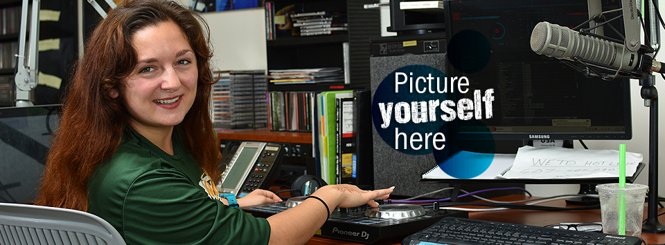 Picture yourself here. Image of female student DJ working in the WETD radio station.