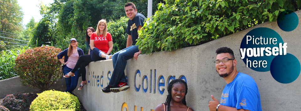 Picture yourself here. Image of students on the stone Alfred State College SUNY monument at the entrance of campus.