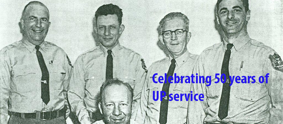 five original university police members in uniform; celebrating 50 years of UP service