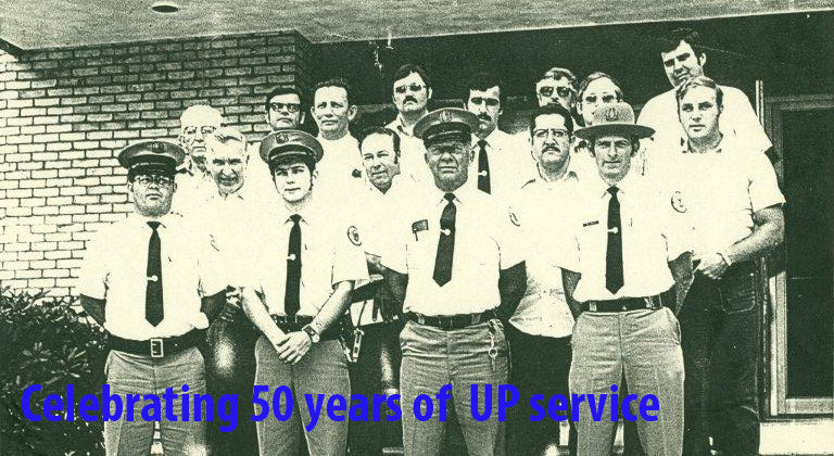 several university police officers in uniform; celebrating 50 years of university police service