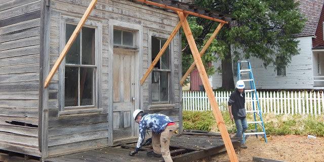 students repairing a porch