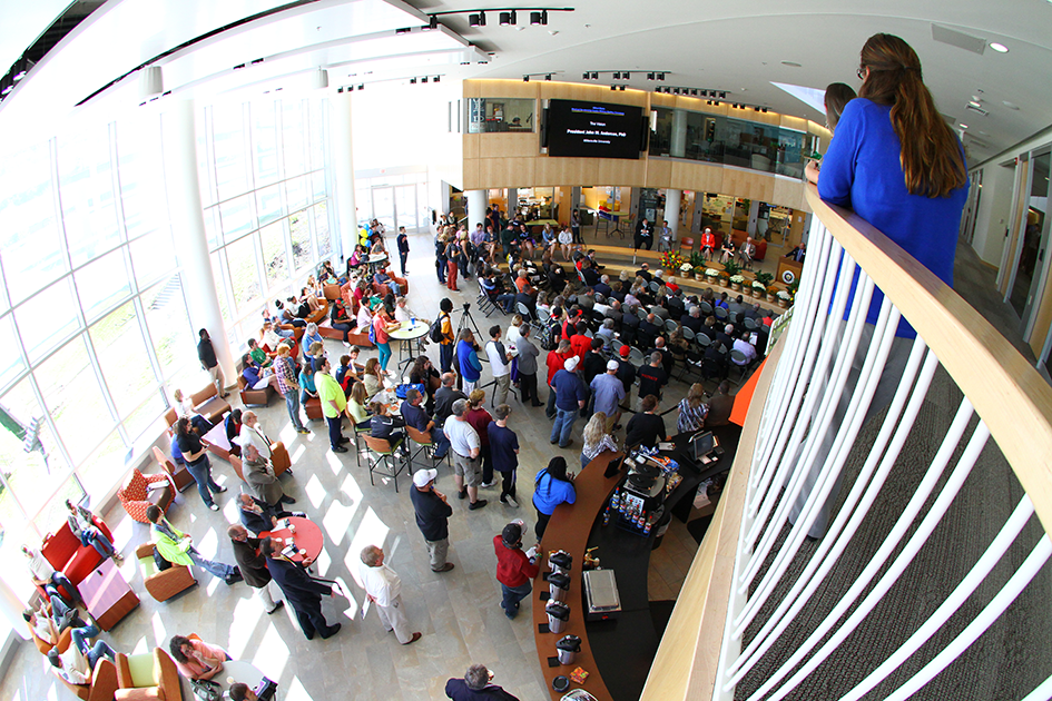 view looking down in the Center with many students, faculty, and staff standing