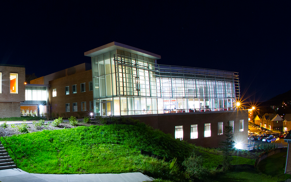 night view of Student Leadership Center all lit up at night