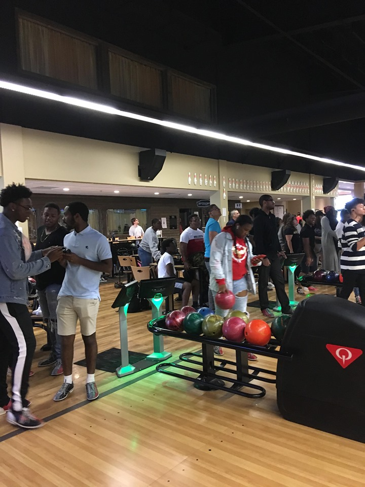 students in a bowling alley