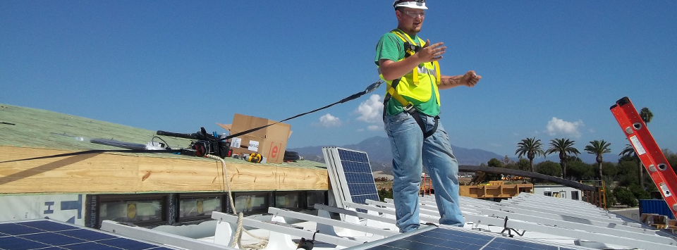 male student installing solar panels