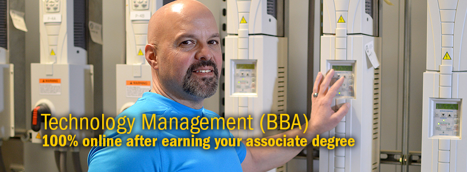 Technology Management (BBA) 100% online after earning your associate degree. Image of a man near HVAC equipment