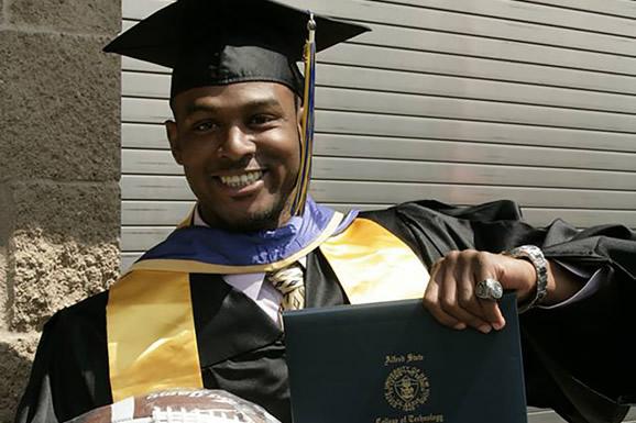 Thomas Daniels holding diploma