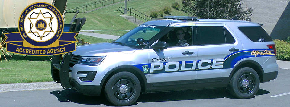 Logo showing Accredited Agency of New York State Law Enforcement Accreditation Program logo over a photo of the University Police car