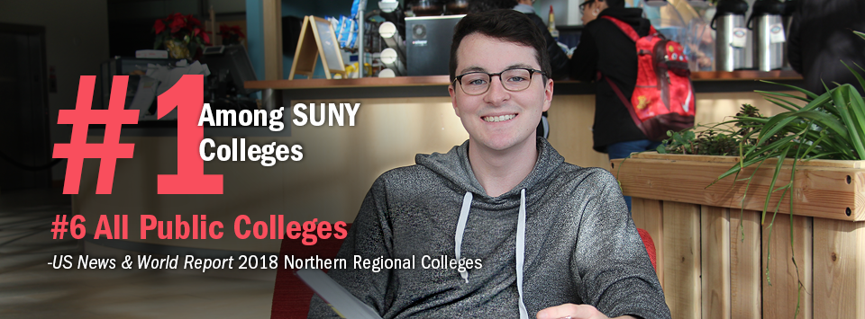 #1 Among SUNY Colleges. #6 All Public Colleges - US News & World Report, 2018 Northern Regional Colleges. Image of male with glasses holding book smiling for camera with coffee shop behind him.