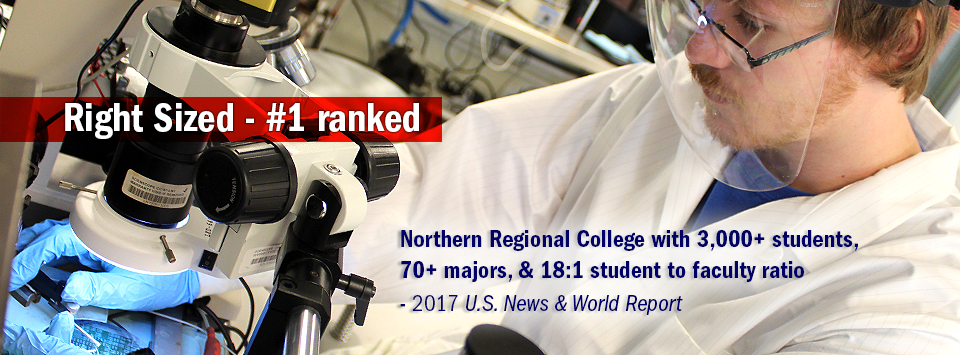 Male student with safety shield, gloves, and white coat working with microscope in the Nano Lab. Text reads:  Right Sized #1 ranked Northern Regional College with 3,000+ students,  70+ majors, & 18:1 student to faculty ratio - 2017 U.S. News & World Report