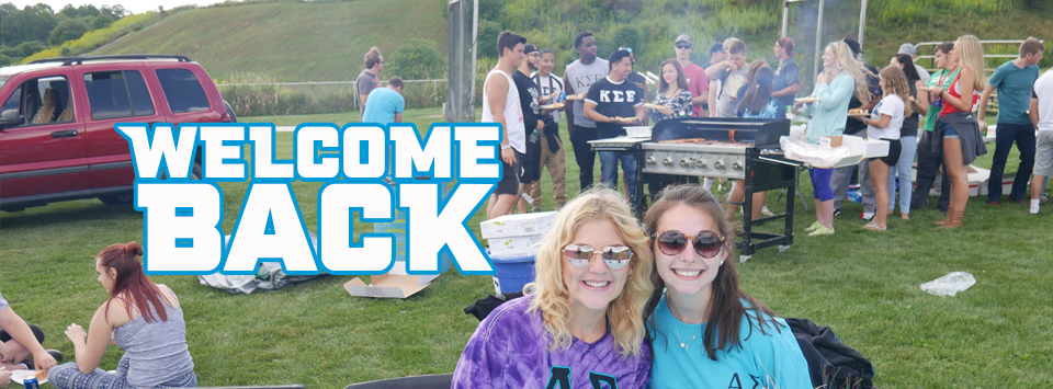 Welcome Back. Image of students enjoying a cook out before classes start.