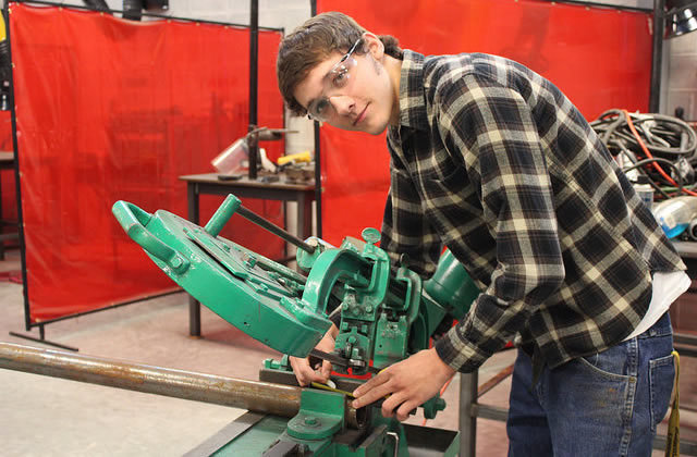 student in the welding lab