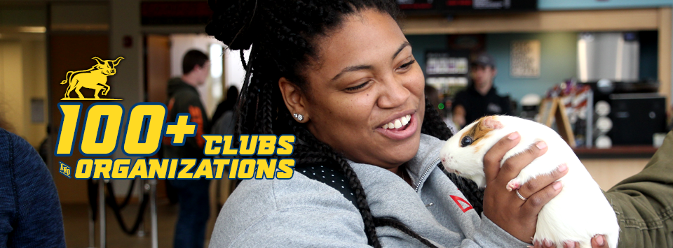 100+ Clubs and Organizations. Image of student smiling at a guinea pig.