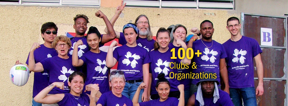 100+ Clubs and Organizations. Image of group of faculty and students who volunteered in Puerto Rico showing muscles wearing matching All Hands and Hearts Smart response shirts